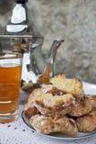 Чай с печеньями миндалины Стоковое Изображение