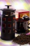 Чай и чайник на красивейшей предпосылке Стоковое Изображение
