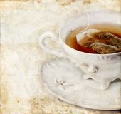 чай grunge чашки предпосылки Стоковая Фотография