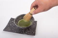 Чай Matcha японца в руке Стоковое Изображение