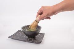 Чай Matcha японца в руке Стоковые Фото