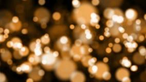 Частицы абстрактного bokeh золотые акции видеоматериалы