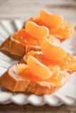 Части багета с оранжевым мармеладом Стоковые Фото