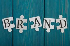 Части головоломки с словом & x22; Brand& x22; стоковое фото rf