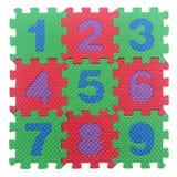Части головоломки алфавита номеров на белизне Стоковые Изображения