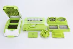 Части и комплект slicer или dicer еды вырезывания точности зеленого цвета нержавеющей стали современных для плодоовощ, сыра, овощ Стоковые Фото
