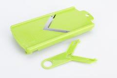 Части и комплект slicer или dicer еды вырезывания точности зеленого цвета нержавеющей стали современных для плодоовощ, сыра, овощ Стоковое фото RF