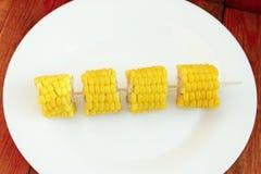 Части кипеть corns на плите Стоковое Фото