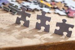 3 части мозаики на таблице Стоковое Изображение