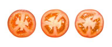 Части отрезанного томата изолированного на белизне Стоковое Изображение