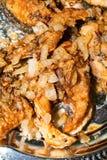 Части рыб зажарили в сковороде с маслом Стоковые Изображения RF