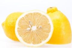 Части свежего желтого плодоовощ лимона на белой предпосылке Стоковое Изображение