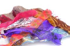 Части ткани которые были выведены от шить - куча ткани Стоковая Фотография RF