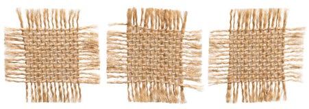 Части ткани мешковины, деревенская гессенская ткань, сорванная заплата мешка Стоковое Изображение RF