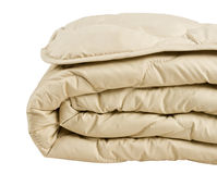 Часть бежевого одеяла изолированная на белой предпосылке стоковое фото