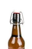 Часть бутылки пива на белизне Стоковое Изображение