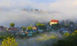 Часть города Dalat в тумане утра Стоковая Фотография