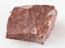 часть грубого красного мраморного камня на белизне Стоковое фото RF