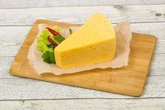 часть желтого сыра стоковые изображения