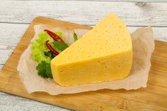 Часть желтого сыра стоковые фото