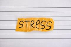 Часть желтой бумаги с стрессом слова стоковая фотография rf