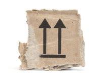 Часть картона при стрелки указывая вверх Стоковые Фото