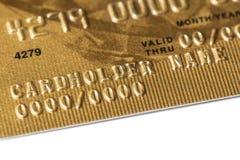 Часть карточки золота банка пластичной Стоковые Изображения