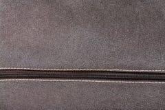 Часть крупного плана коричневой ткани с молнией Стоковые Фотографии RF