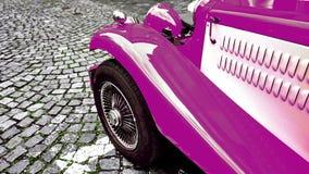 Часть лицевой стороны винтажного классического фиолетового автомобиля горячей штанги на дороге мостить стоковые фото