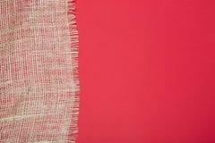 Часть мешковины на красном цвете Стоковая Фотография RF