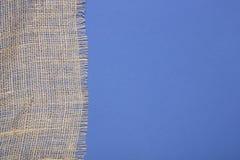 Часть мешковины на сини Стоковая Фотография RF