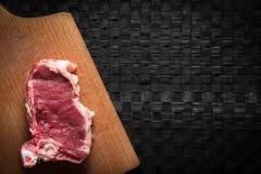 Часть мяса на прерывая доске Стоковые Фотографии RF