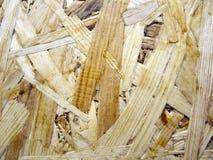 Часть отлитой в форму плиты OSB сделанной от деревянного крупного плана обломоков Стоковая Фотография RF