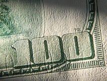 Часть долларовой банкноты 100 Стоковое фото RF