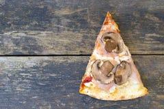 Часть пиццы стоковое фото