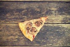 Часть пиццы стоковая фотография