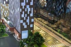 Часть плана улиц города, дорог с автостоянкой автомобиля, зданий Модель города архитектурноакустическая, maquette Стоковое Фото