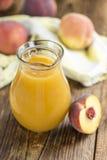 Часть сока персика Стоковое Фото