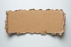 Часть сорванная картоном стоковая фотография rf