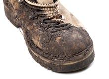 Часть старого пакостного пешего ботинка на белой предпосылке Стоковая Фотография