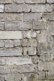 Часть старой кирпичной стены врем-удостоена Стоковая Фотография RF