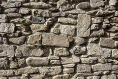 Часть старой стены серых камня и кирпича Стоковое Фото