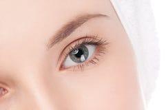 Часть стороны женщины: глаз крупного плана Стоковые Изображения RF