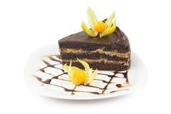 Часть торта на плите Стоковые Фотографии RF