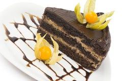 Часть торта на плите Стоковые Фото