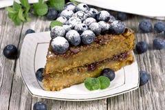Часть торта с голубиками Стоковые Изображения RF