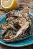 Часть душистых зажаренных в духовке рыб Стоковое Фото