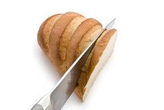 часть хлеба knifing Стоковые Изображения