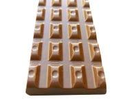 Часть шоколада на белизне Стоковые Изображения