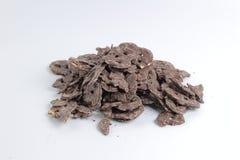 часть шоколада на земле задней части белизны Стоковое фото RF
